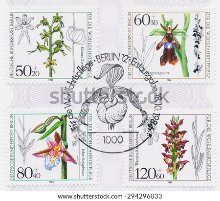GERMANY - CIRCA 1984: A  first day of issue postmark printed in Germany, shows Orchid Type, Listera cordata, Ophrys insectifera, Epipactis palustris, Ophrys coriophora, circa 1984 - stock photo