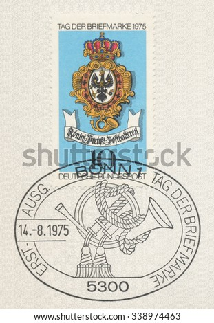 GERMANY - CIRCA 1975: A  first day of issue postmark printed in Germany, shows Sign of Royal Prussian Post and postal horn, circa 1975 - stock photo
