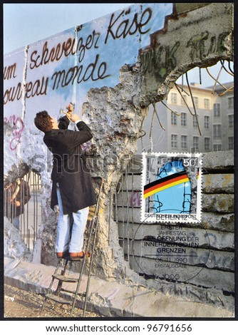 GERMANY - CIRCA 1990: A postcard printed in Germany, is dedicated to the first anniversary of the fall of the Berlin Wall, circa 1990 - stock photo