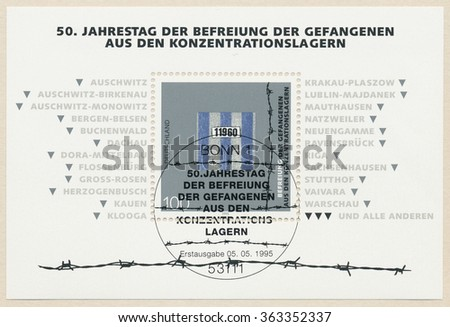 GERMANY - CIRCA 1995: A postmark printed in Bonn, shows List of concentration camps, prisoner number on the robed, 50 anniversary of the liquidation of the concentration camps, circa 1995 - stock photo