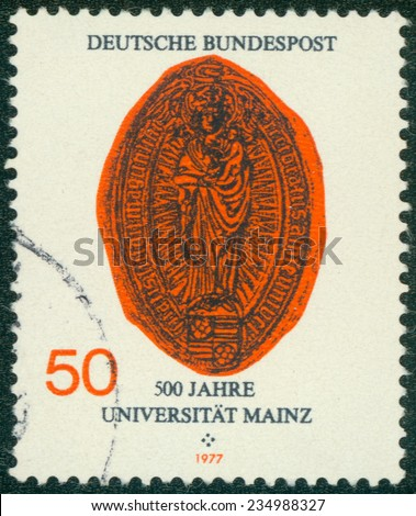 GERMANY - CIRCA 1977: A stamp dedicated to The Johannes Gutenberg University of Mainz is a university in Mainz, Rhineland Palatinate, Germany, named after the printer Johannes Gutenberg, circa 1977. - stock photo