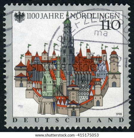 GERMANY - CIRCA 1998: A stamp printed by Germany, shows city, Europe, medieval Gothic Cathedral, city, circa 1998 - stock photo