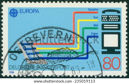 GERMANY - CIRCA 1988: A stamp printed in German Federal Republic dedicated to Transport and communication, shows the Integrated Services Digital Network (ISDN) system, circa 1988 - stock photo
