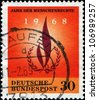 GERMANY- CIRCA 1968: A stamp printed in German Federal Republic shows Human Rights Flame, circa 1968 - stock photo
