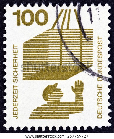 """GERMANY - CIRCA 1971: A stamp printed in Germany from the """"Accident Prevention"""" issue shows crate on hoist, circa 1971. - stock photo"""
