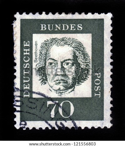 """GERMANY - CIRCA 1961: A stamp printed in Germany from the """"Famous Germans"""" issue showing German composer and pianist Ludwig van Beethoven, circa 1961. - stock photo"""