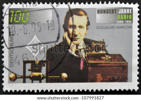 GERMANY - CIRCA 1995: A stamp printed in Germany shows Guglielmo Marconi and Transmitting Equipment, Centenary of Radio, circa 1995 - stock photo