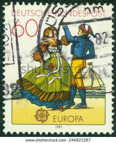 GERMANY - CIRCA 1981: a stamp printed in Germany shows North German couple dancing in regional costumes, circa 1981 - stock photo