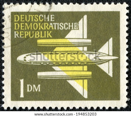 GERMANY - CIRCA 1957: A stamp printed in Germany, shows Stylized Plane, circa 1957 - stock photo