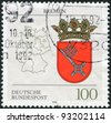GERMANY - CIRCA 1992: A stamp printed in Germany, shows the coat of arms of the Federal Land Bremen and the German map, circa 1992 - stock photo