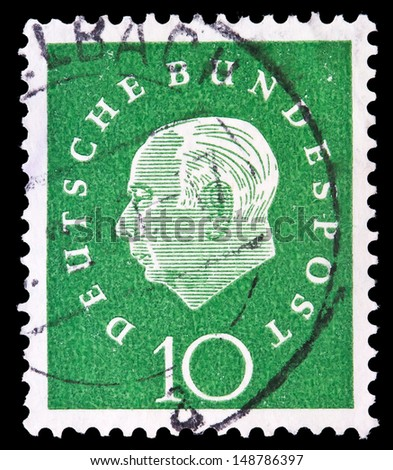 GERMANY - CIRCA 1959: A stamp printed in Germany shows the first President of the Federal Republic of Germany Theodor Heuss, circa 1959.   - stock photo