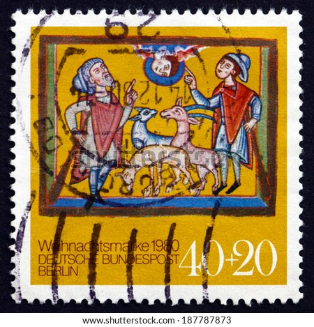 GERMANY - CIRCA 1980: a stamp printed in the Germany, Berlin shows Annunciation to the Shepherds, from Altomunster Manuscript, 12th Century, Christmas, circa 1980 - stock photo