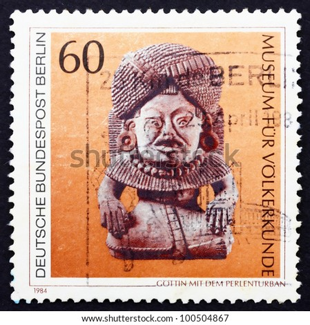 GERMANY - CIRCA 1984: a stamp printed in the Germany Berlin shows Stone God with Beaded Turban, Mexico, Ancient Artwork, circa 1984 - stock photo