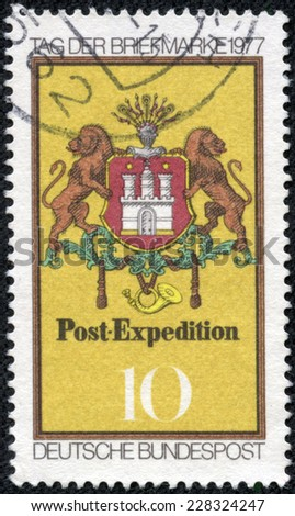 GERMANY - CIRCA 1977: a stamp printed in the Germany shows Arms of Hamburg, Post Emblem, 1861, Stamp Day, circa 1977 - stock photo