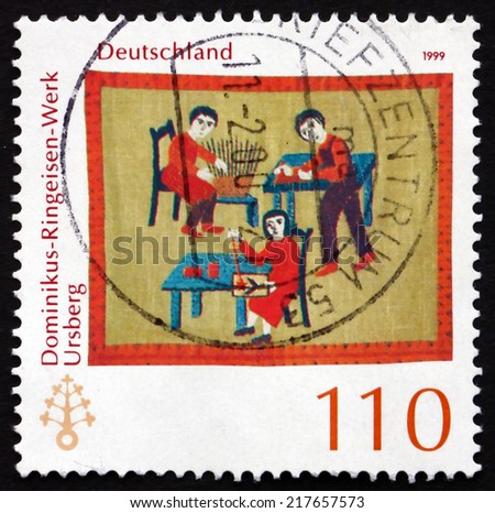 GERMANY - CIRCA 1999: a stamp printed in the Germany shows Dominikus-Ringeisen Institution, Ursberg, 115th Anniversary, circa 1999 - stock photo