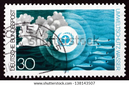 GERMANY - CIRCA 1973: a stamp printed in the Germany shows Environment Emblem and pollution of the Water, Nature and Environmental Protection, circa 1973 - stock photo