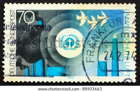GERMANY - CIRCA 1973: a stamp printed in the Germany shows Environment Emblem and pollution of the Air, Nature and Environmental Protection, circa 1973 - stock photo