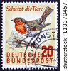 GERMANY - CIRCA 1957: a stamp printed in the Germany shows European Robin, Bird, Protection of Wild Animals and Plants, circa 1957 - stock photo