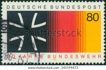 GERMANY - CIRCA 1985: a stamp printed in the Germany shows Iron Cross and National Colors, 30th Anniversary of National Armed Forces, circa 1985 - stock photo