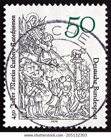 GERMANY - CIRCA 1979: a stamp printed in the Germany shows Moses Receiving Tablets of the Law, Illustration by Lucas Cranach, circa 1979 - stock photo