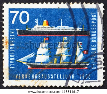 GERMANY - CIRCA 1965: A stamp printed in the Germany shows Sailing Ship and Ocean Liner, circa 1965 - stock photo