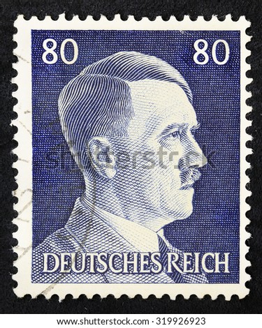 GERMANY - CIRCA 1945: A vintage German Reich Postage Stamp shows portrait of Adolf Hitler, circa 1945. - stock photo