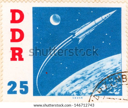 GERMANY - CIRCA 1963: An old German Democratic Republic postage stamp issued in honor of the Soviet spacecraft Vostok and second human to orbit the Earth, cosmonaut Gherman Titov; series, circa 1963 - stock photo