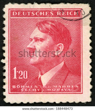 GERMANY - CIRCA 1942: post stamp printed in the Protectorate Czech and Morava shows portrait of Adolf Hitler (politician, leader of Nazi Party, dictator, veteran of World War), 1.20 red, circa 1942 - stock photo