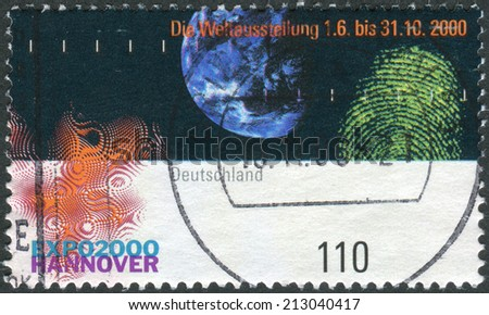 GERMANY - CIRCA 2000: Postage stamp printed in Germany, dedicated to the EXPO 2000, Hannover, depicts Earth, fingerprint and emblem, circa 2000  - stock photo