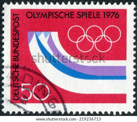 GERMANY - CIRCA 1976: Postage stamp printed in Germany, dedicated to the 12th Winter Olympic Games, Innsbruck, Austria, shows the Olympic Rings, Symbolic Mountains, circa 1976 - stock photo