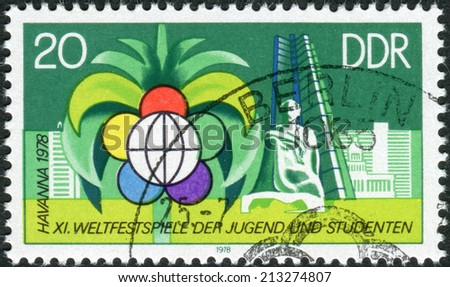 GERMANY - CIRCA 1978: Postage stamp printed in Germany (GDR), dedicated to 11th World Youth Festival, Havana, shows Festival Emblem and New Buildings, Havana, circa 1978  - stock photo