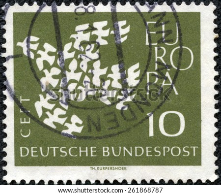 GERMANY - CIRCA 1961: Postage stamp printed in Germany, shows 19 pigeons, arranged as a flying Dove, circa 1961 - stock photo