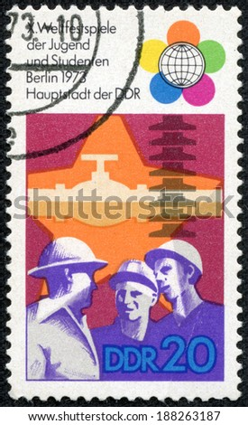 GERMANY - CIRCA 1973: stamp printed by Germany, shows the emblem of the Tenth World Festival of Youth and students, circa 1973. - stock photo