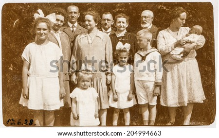GERMANY, CIRCA TWENTIES - Vintage photo of big family with a baby - stock photo