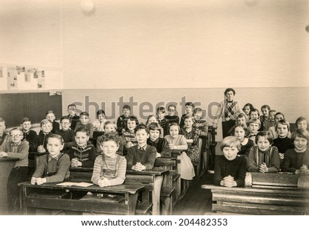 GERMANY, CIRCA 1953 - Vintage photo of group of schoolmates in their classroom - stock photo