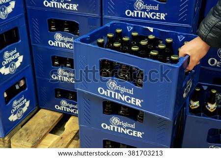 GERMANY - DECEMBER 21, 2015: Oettinger beer crates in a Hypermarket. Oettinger has been Germany's best selling beer brand. Various German beers are discredited because of poison residues in beer. - stock photo