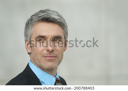 Germany, Hamburg, Businessman looking away - stock photo