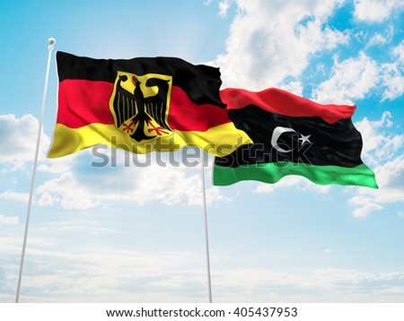 Germany & Libya Flags are waving in the sky - stock photo