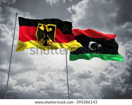 Germany & Libya Flags are waving in the sky with dark clouds - stock photo