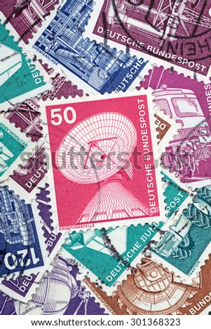GERMANY - MAY 15, 1975: Macro photo of a German stamp about Earth Stations from the Industry and Technics - stock photo