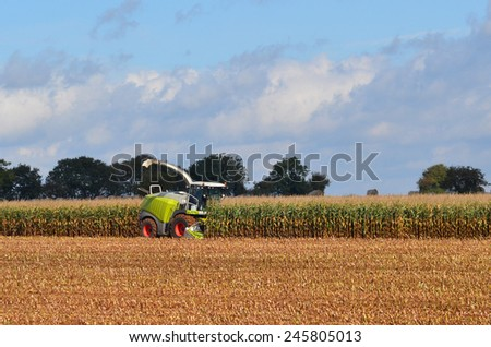 Germany - Schleswig Holstein - October 10, 2014: corn harvester in the Corn crop - stock photo