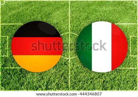 Germany vs Italy icons at football field background - stock photo
