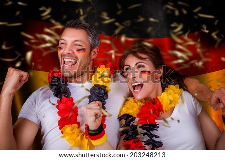 germany winner couple smiling happy - stock photo