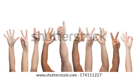 gesture and body parts concept - human hands showing thumbs up, ok and peace signs - stock photo