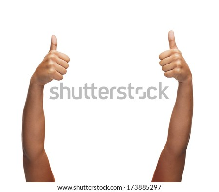 gesture and body parts concept - woman hands showing thumbs up - stock photo
