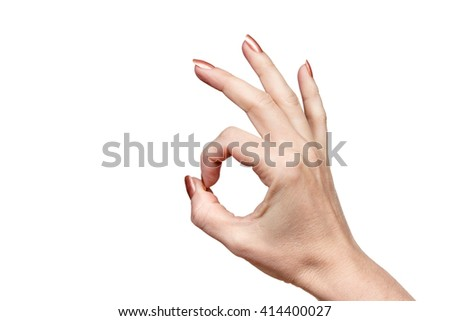 Gesture by one female hand ok isolated on white background - stock photo