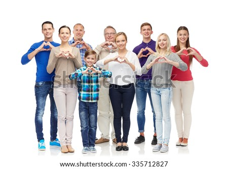 gesture, family, generation and people concept - group of smiling men, women and boy showing heart shape hand sign - stock photo