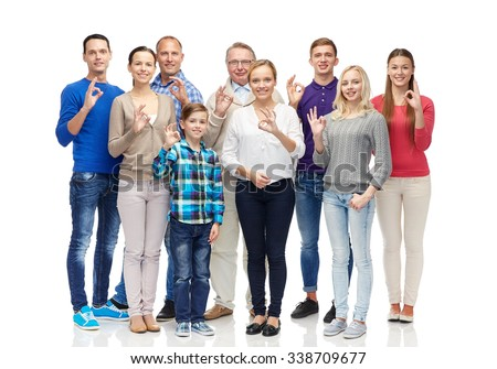 gesture, family,  generation and people concept - group of smiling men, women and boy showing ok hand sign - stock photo