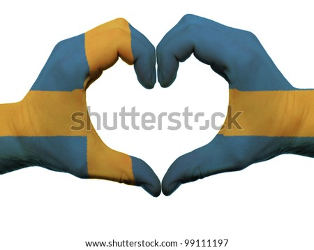 Gesture made by sweden flag colored hands showing symbol of heart and love, isolated on white background - stock photo