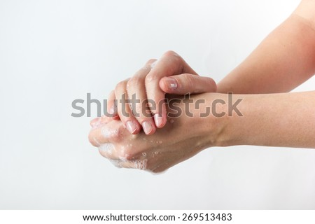 gesture of a beautiful woman hand washing her hands on white background - stock photo